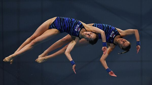 Russia's Iuliia Timoshinina (L) and Russia's Ekaterina Beliaeva compete in the Women's Synchronised 10m Platform Diving event during the LEN European Aquatics Championships at the Duna Arena in Budapest on May 14, 2021. (Photo by Attila KISBENEDEK / AFP)