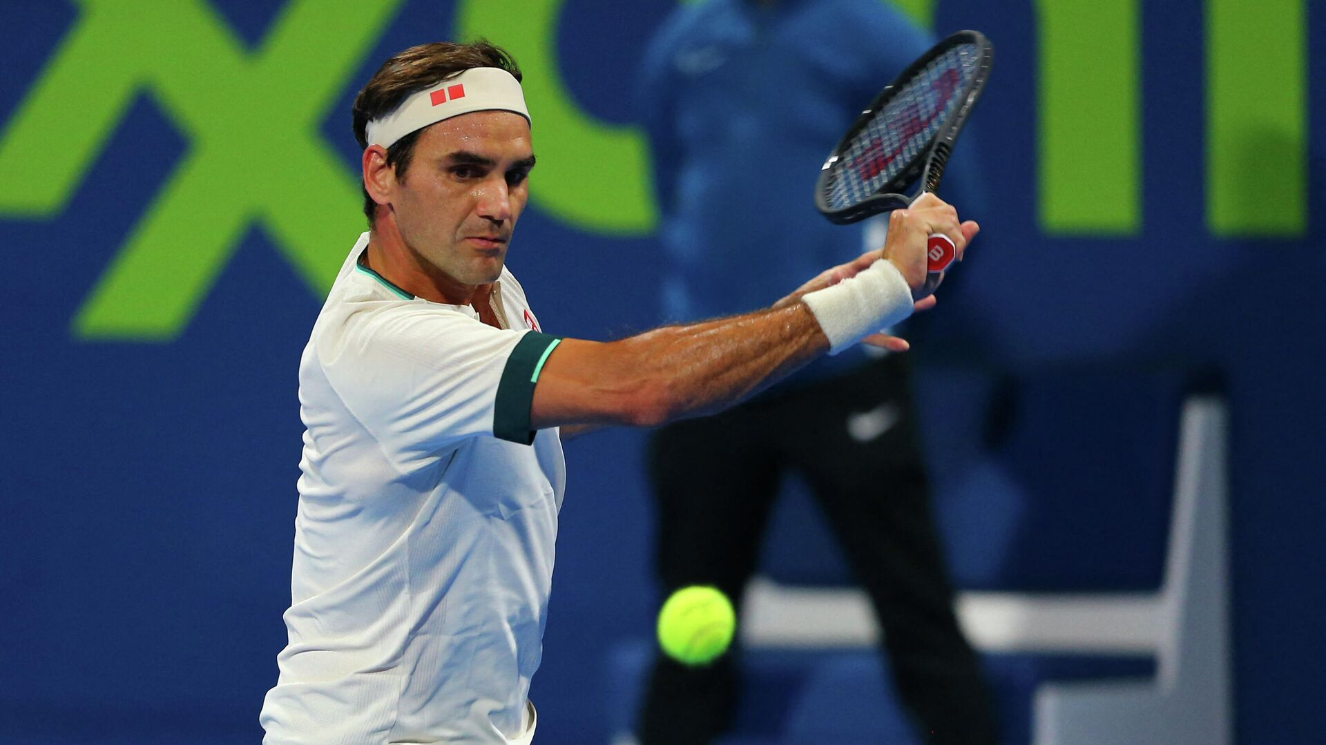 A handout picture obtained from the Qatar Tennis Federation on March 11, 2021, shows Roger Federer returns the ball during his match with Nikoloz Basilashvili of Georgia at the Qatar ExxonMobil Open at the Khalifa International Tennis and Squash Complex in the Qatari capital Doha. - Federer squandered a match point and was knocked out of the Qatar Open by Basilashvili in just his second match since a 13-month injury absence. (Photo by Samer Al-Rejjal / Qatar Tennis Federation / AFP) / RESTRICTED TO EDITORIAL USE - MANDATORY CREDIT AFP PHOTO / QATAR TENNIS FEDERATION  - NO MARKETING - NO ADVERTISING CAMPAIGNS - DISTRIBUTED AS A SERVICE TO CLIENTS - РИА Новости, 1920, 15.05.2021