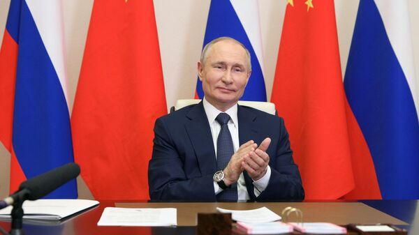 Президент РФ Владимир Путин принимает участие по видеосвязи в церемонии начала строительства энергоблоков №7 и №8 Тяньваньской АЭС и энергоблоков №3 и №4 АЭС Сюйдапу в Китае