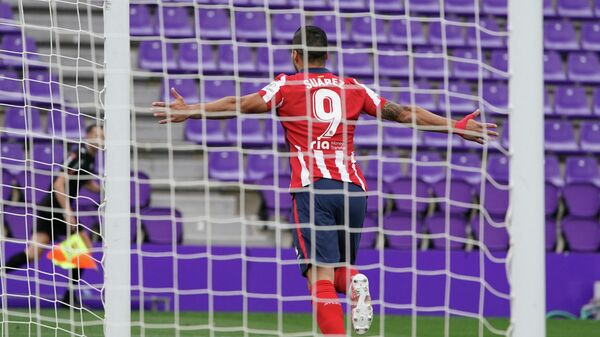 Atletico Madrid's Uruguayan forward Luis Suarez  celebrates after scoring during the Spanish league football match Real Valladolid FC against Club Atletico de Madrid at the Jose Zorilla stadium in Valladolid on May 22, 2021. (Photo by CESAR MANSO / AFP)