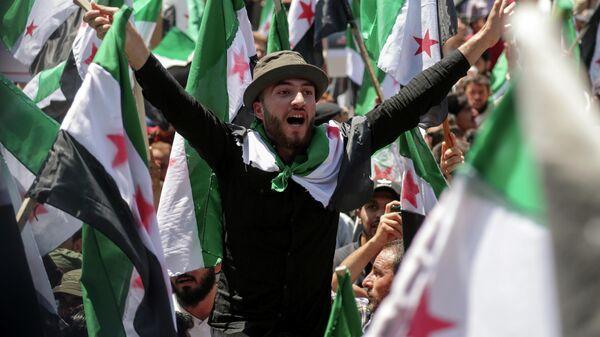 Демонстрация против президента Сирии Башара Асада и президентских выборов в Идлибе, Сирия
