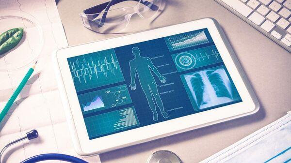 Планшетный компьютер с программой на тему здоровье человека
