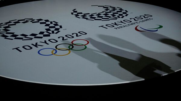 The emblems of the Tokyo 2020 Olympic and Paralympic Games are displayed during an event to unveil the medals, podium and music to be used for the medal ceremonies at the Tokyo 2020 Olympics Games at Ariake Arena in Tokyo on June 3, 2021. (Photo by ISSEI KATO / POOL / AFP)