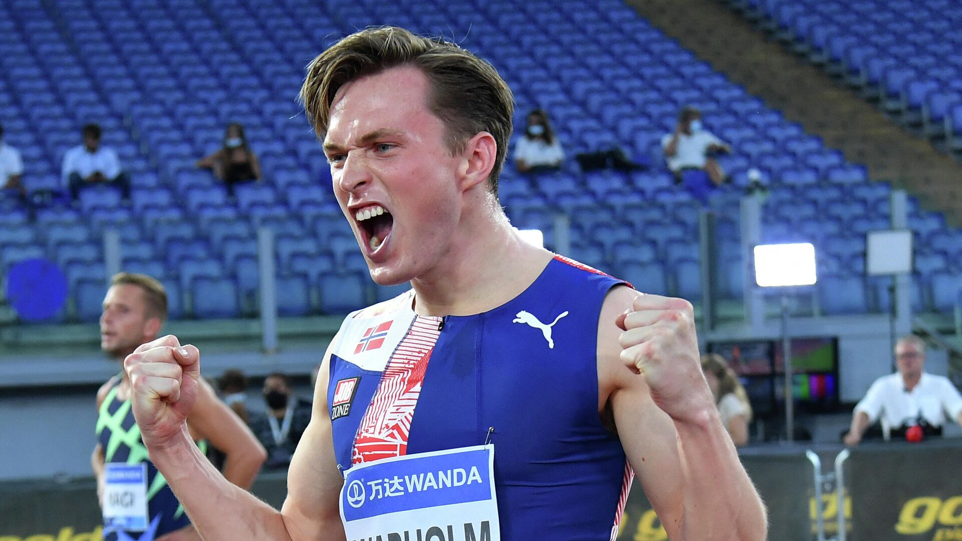 Norway's Karsten Warholm celebrates after wins in the men's 400mt Hurdles final during the IAAF Diamond League competition on September 17, 2020 at the Olympic stadium in Rome. (Photo by Andreas SOLARO / AFP) - РИА Новости, 1920, 01.07.2021
