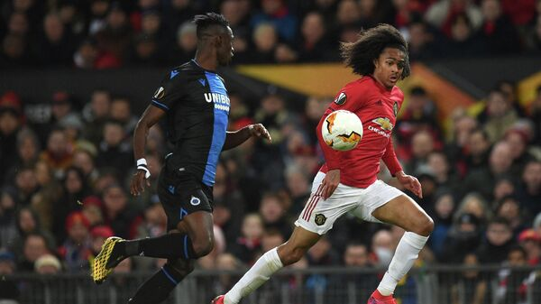 Club Brugge's Ivorian defender Odilon Kossounou (L) vies with Manchester United's Dutch midfielder Tahith Chong during the UEFA Europa League round of 32 second leg football match between Manchester United and Club Brugge at Old Trafford in Manchester, north west England, on February 27, 2020. (Photo by Oli SCARFF / AFP)