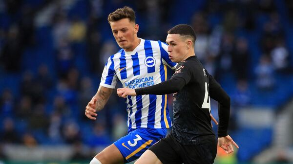 Manchester City's English midfielder Phil Foden runs past Brighton's English defender Ben White to scores his team's second goal during the English Premier League football match between Brighton and Hove Albion and Manchester City at the American Express Community Stadium in Brighton, southern England on May 18, 2021. (Photo by Gareth Fuller / POOL / AFP) / RESTRICTED TO EDITORIAL USE. No use with unauthorized audio, video, data, fixture lists, club/league logos or 'live' services. Online in-match use limited to 120 images. An additional 40 images may be used in extra time. No video emulation. Social media in-match use limited to 120 images. An additional 40 images may be used in extra time. No use in betting publications, games or single club/league/player publications. /