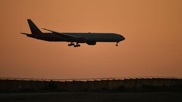 Пассажирский авиалайнер Boeing 777-31H(ER) авиакомпании Россия