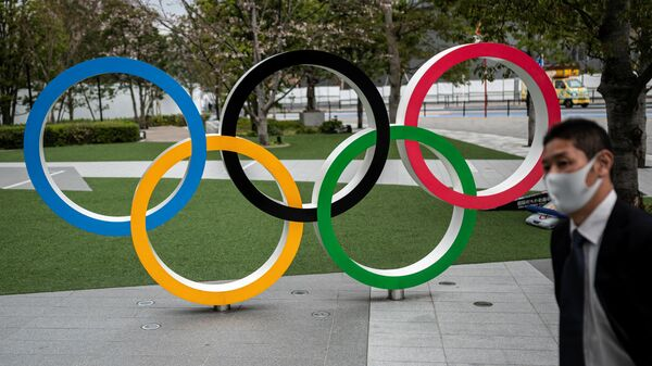 This picture shows the Olympic Rings outside the Japan Olympic Museum in Tokyo on March 22, 2021. (Photo by Charly TRIBALLEAU / AFP)