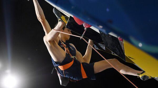 Хэмиш Макартур в финальных соревнованиях по скалолазанию в дисциплине лазание на трудность среди мужчин на чемпионате мира по скалолазанию в Москве
