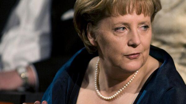 Канцлер Германии Ангела Меркель во время открытия оперы в Осло. 12 апреля 2008 года