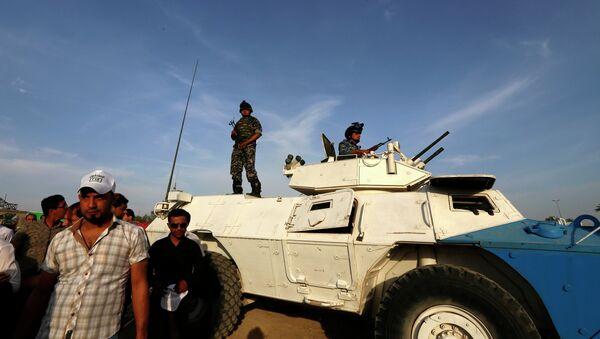 Иракская полиция в Багдаде, после теракта, произошедшего 27 апреля 2014