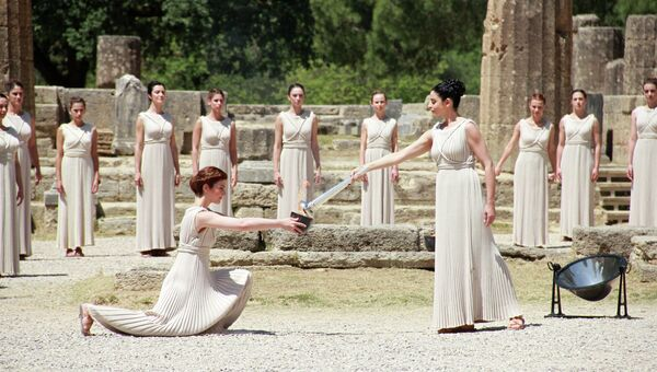 Зажжение олимпийского огня в Древней Олимпии, архивное фото