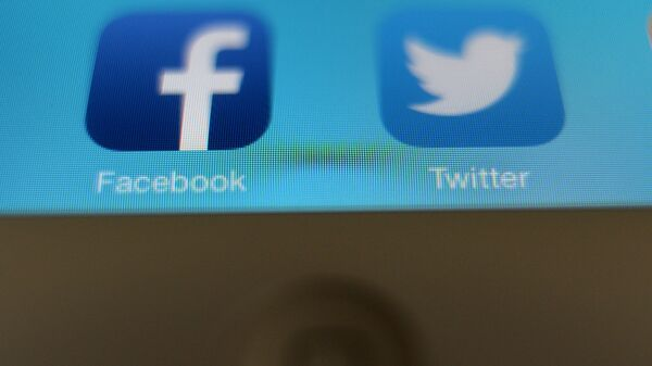 Иконки приложений Facebook и Twitter