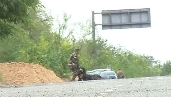 На месте минометного обстрела в поселке Металлист под Луганском