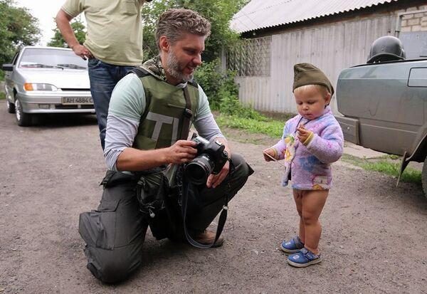 Фотограф МИА Россия сегодня Андрей Стенин