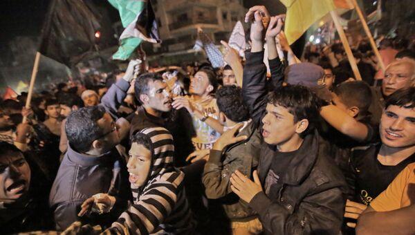 Жители Газы празднуют вступление в силу соглашения о прекращении огня между Израилем и движением ХАМАС. Архивное фото