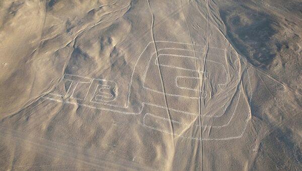 Различимый из космоса логотип телеканала ТВ-3 создан в пустыне Наска в Перу