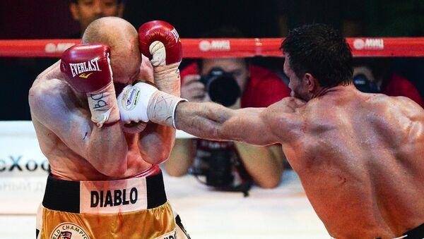 Григорий Дрозд в поединке за звание чемпиона мира по версии WBC против Кшиштофа Влодарчика