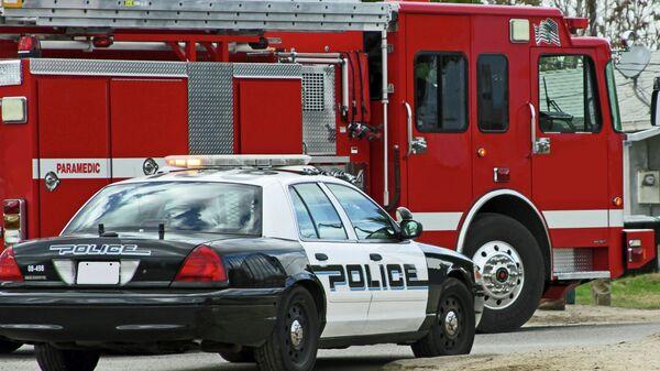 Автомобиль полиции и пожарная машина в США, архивное фото