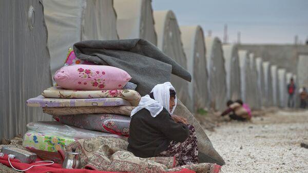Курдская беженка из Кобани, Сирия. Архивное фото