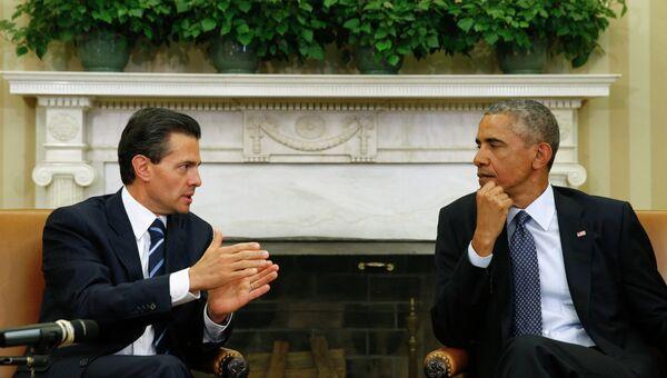 Энрике Пенью Ньето и Барак Обама на встрече в Вашингтоне.