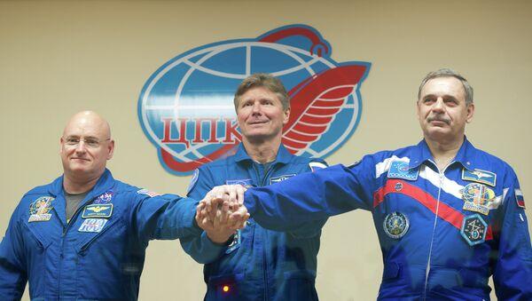 Американский астронавт Скотт Келли, российские космонавты Геннадий Падалка, Михаил Корниенко. Архивное фото