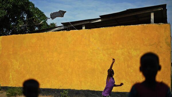 Девочка на улице Бужумбуры, столицы Бурунди