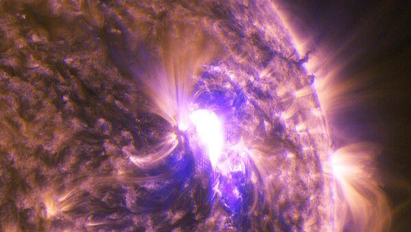 Снимок вспышки на Солнце, полученный камерами зонда SDO