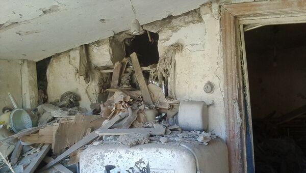 Последствия обстрела в ЛНР. Архивное фото