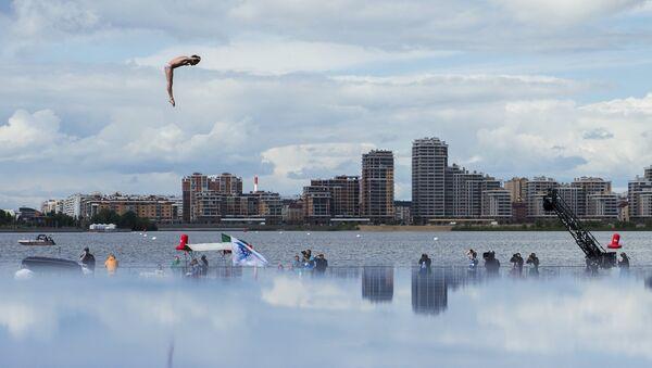 Гэри Хант (Великобритания) в соревнованиях по прыжкам в воду с вышки 27 м на XVI чемпионате мира по водным видам спорта в Казани. Архив