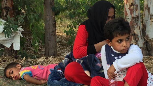 Сирийские беженцы в пригороде Аккара на севере Ливана. Архивное фото