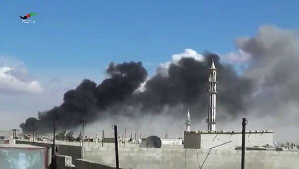 Последствия авиаудара по пригороду Хомса, Сирия. Архивное фото