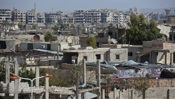 Разрушенные здания в городе Маадамия в пригороде Дамаска. Архивное фото