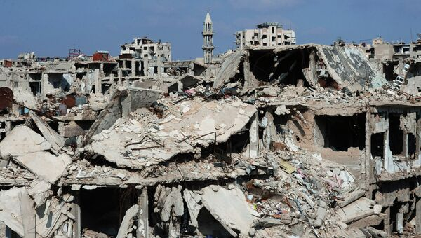 Разрушенные жилые дома в сирийском городе Хомс. Архивное фото