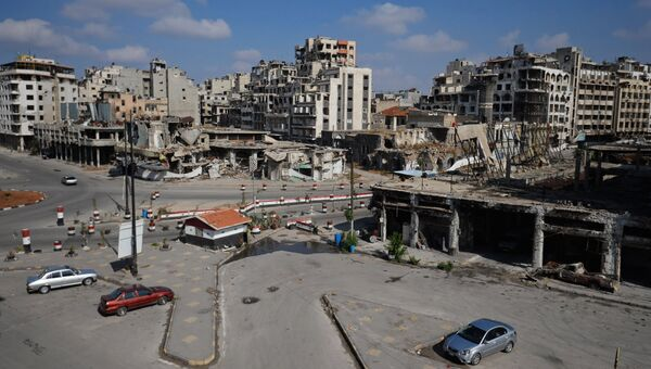 Разрушенные здания в сирийском городе Хомс. Архивное фото