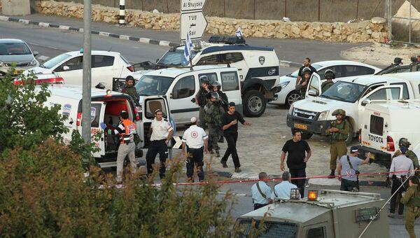 Место, где палестинец совершил наезд на израильских пограничников, к северу от города Хеврона