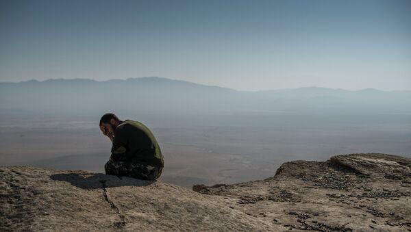 Боец Сирийского народного ополчения. Архивное фото