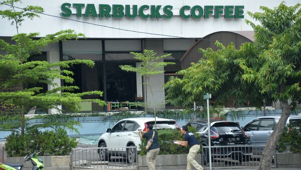 На месте взрыва в Джакарте, 14 января 2016