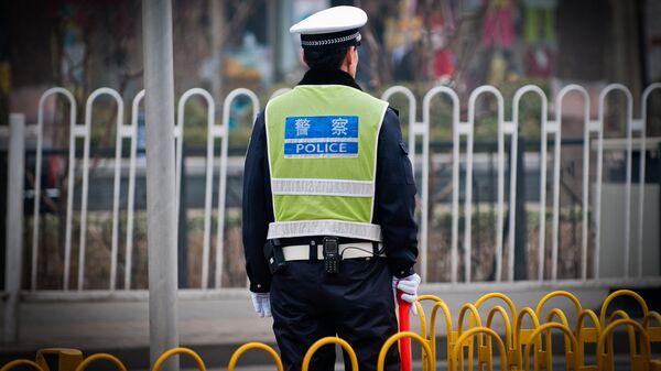 Полицейский, Китай. Архивное фото