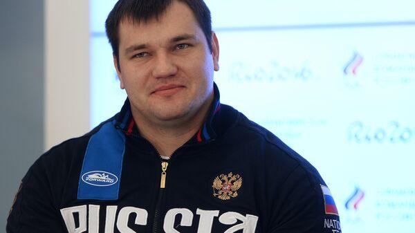 Российский тяжелоатлет Алексей Ловчев