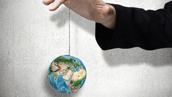 Земной шар на ниточке. Архивное фото