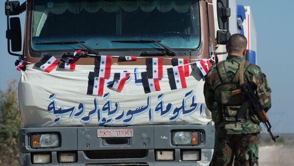 Конвой, доставивший гуманитарную помощь, в поселок Ибта, контролируемый формированиями объявившими о прекращении огня