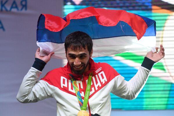 Российский дзюдоист Хасан Халмурзаев, завоевавший золотую медаль в мужском турнире по дзюдо