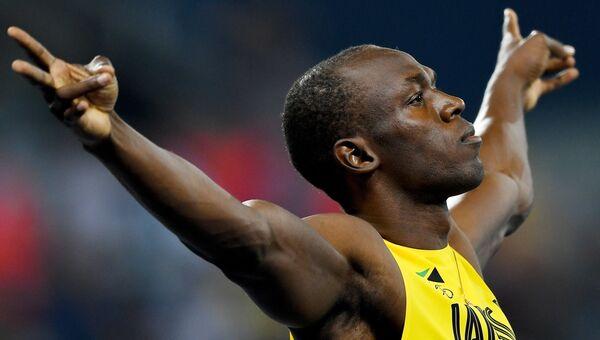 Усэйн Болт на старте полуфинального забега на 100 м на XXXI летних Олимпийских играх