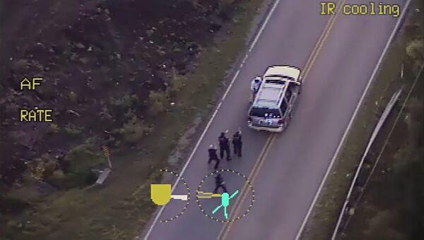 Полиция преследует Теренса Кратчера городе Талса, США. 16 сентября 2016