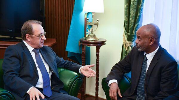 Заместитель министра иностранных дел России Михаил Богданов и государственный министр иностранных дел Республики Судан Камаль Исмаил во время встречи в Москве. 27 сентября 2016