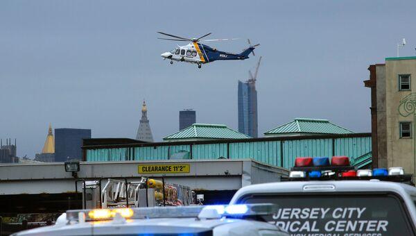 Вертолет над местом железнодорожной катастрофы на станции города Хобокен в штате Нью-Джерси, США. 29 сентября 2016