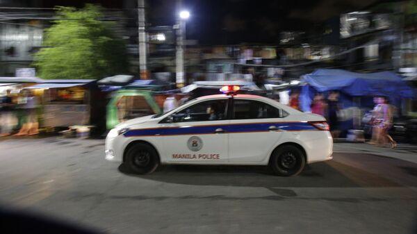 Машина полиции на улице Манилы, Филиппины