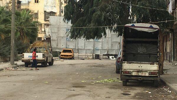 Граница восточного и западного Алеппо на главном КПП Бустан аль-Каср. Архивное фото