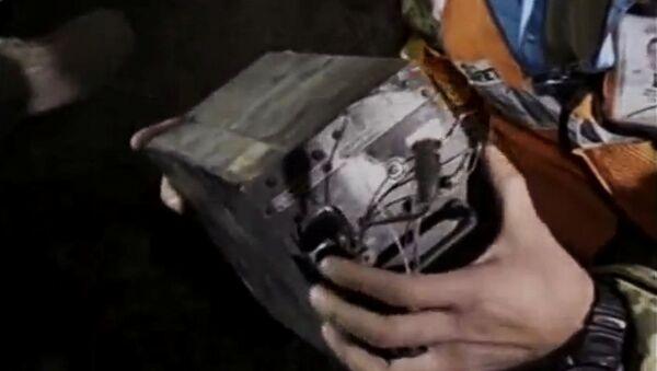 Черный ящик на месте крушения самолета авиакомпании PIA недалеко от Абботтабада, Пакистан